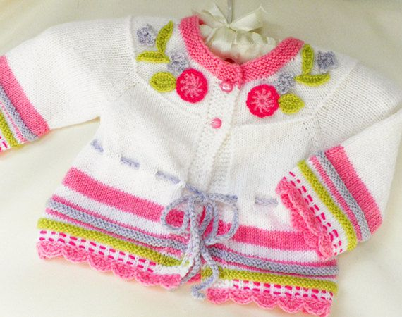 Hand knitted baby cardigan in white and magenta with crocheted flowers, baby clothes, spring vest, Baby fashion,READY TO SHIP. $52.00, via Etsy.