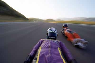 A pair of street luge pilots gain speed on a course in Los Angeles. Street lugers can go as fast as cars -- mere inches from the asphalt.