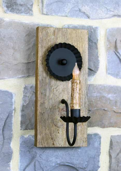 """Handcrafted Candle Wall Sconce made from reclaimed barn wood. Our rustic barnwood sconces are made from genuine wood timbers reclaimed in rural Lancaster County Pennsylvania. Due to the nature of salvaged barn wood each sconce will have its own unique characteristics, no two will be alike. Wood timbers vary in width, markings and wood species, if you order more than 1 item, we will ship you as closely matching items as possible.  Measures Approx. 4.75"""" - 5.75""""W x 12""""L x 7.5&quo..."""