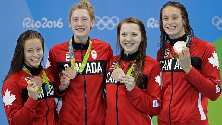 Canada's Katerine Savard, Taylor Ruck, Brittany Maclean and Penny Oleksiak, from left, hold up their bronze medals during the women's 4 x 200-meter freestyle relay medals ceremony during the swimming competitions at the 2016 Summer Olympics, Thursday, Aug. 11, 2016, in Rio de Janeiro, Brazil. (AP Photo/Michael Sohn)