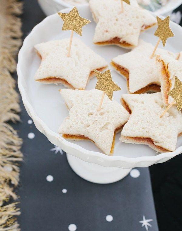 Star shaped sandwiches give a little nutrition during a birthday party. Wonder Woman Party Food | Halfpint Design, party ideas, party themes - Using a cookie cutter can create the perfect shapes for any themed party. Princess, Star Wars, Moana....the sky's the limit!