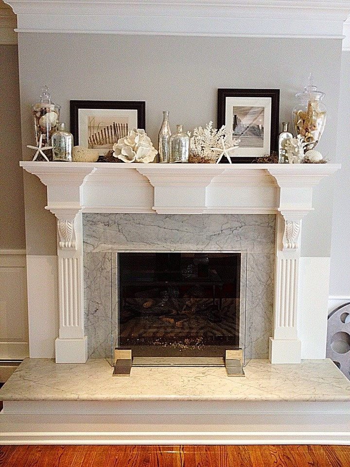My friend Susan's summer mantel with found beach shells and Pottery Barn details! Follow her...she pins good stuff! www.pinterest.com/susanlynnta/