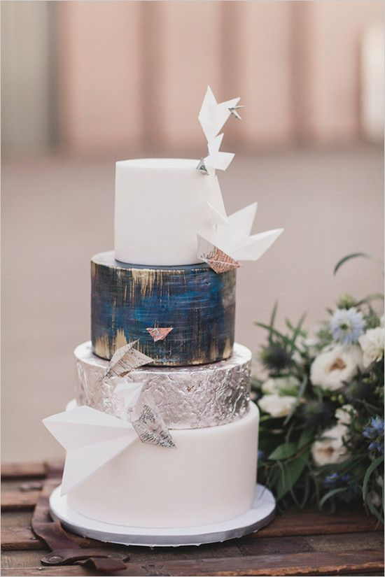 paper airplane blue white and gold wedding cake