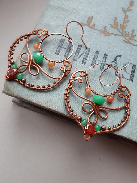 Mood: romantic, boho , feminine, gypsy, eastern Technique: Hand-formed, hand-hammered, wire wrapped and slightly antiqued by Lirimaer Colour: emerald green, pale orange shades of oxidized copper Made of copper wire, copper findings, cubic zirconia, jade, agate Shape: eastern