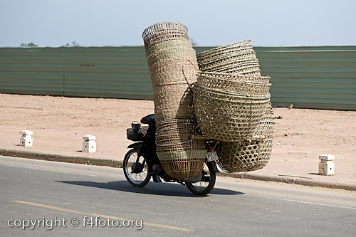 Every bike should have a basket!!!  I love the baskets. Actually saw bikes loaded like this in Kenya and China!: