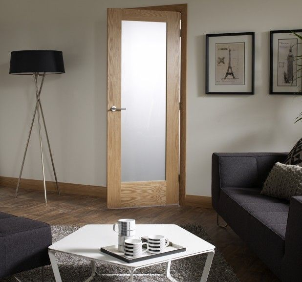 Catchy Oak Interior Door Using Frosted Glass Panel In Charming Living Room  Featuring Black Sofa And