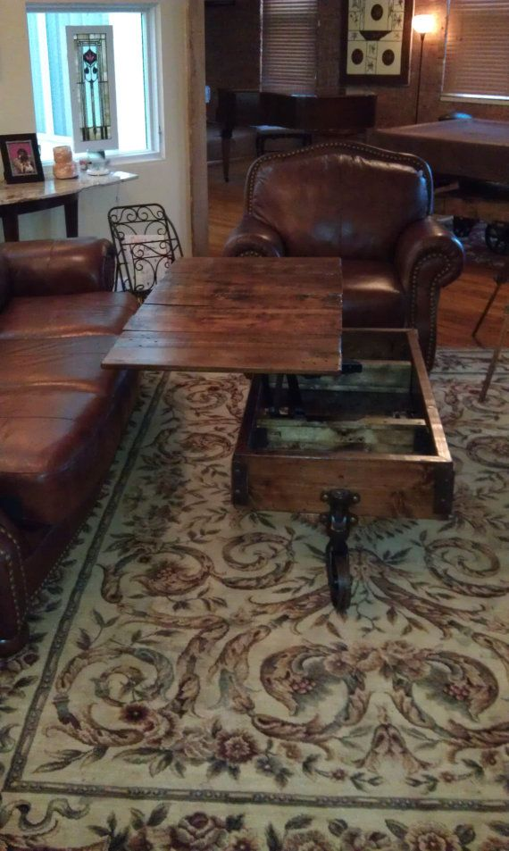 OMG. I need this in my life!  Industrial / warehouse / railroad cart coffee table.