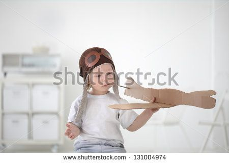 happy boy play in airplane  indoors - stock photo