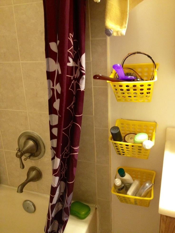 Diy storage for tiny bathroom using dollar store baskets for Bathroom basket storage ideas