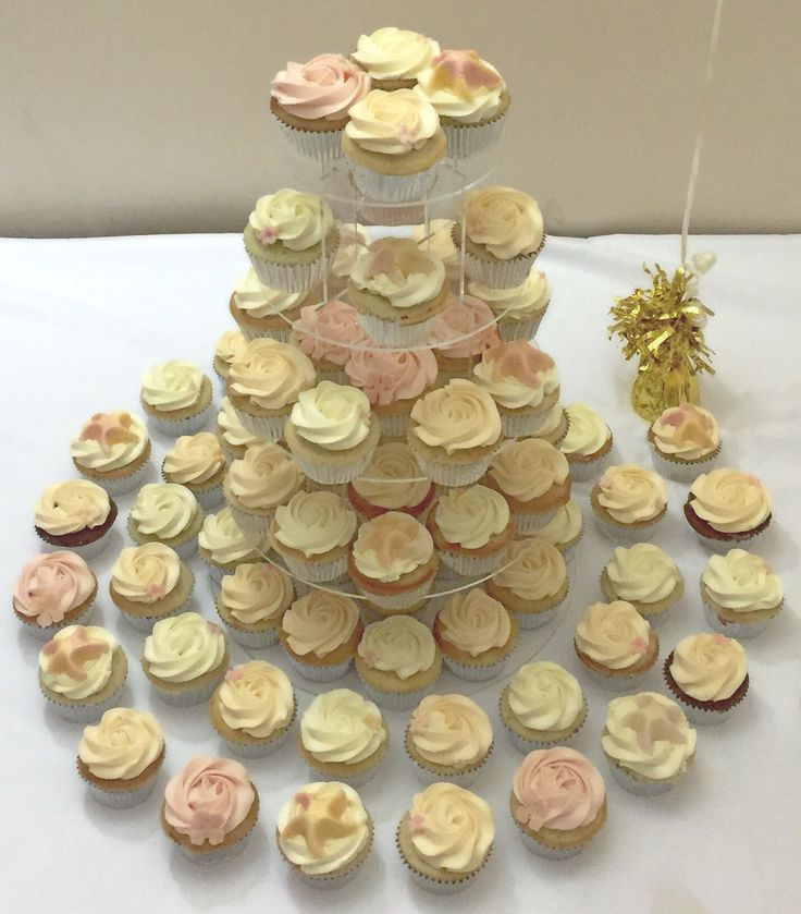 Wedding cupcake tower - a mixture of vanilla cupcakes and pina colada cupcakes in pastel colours