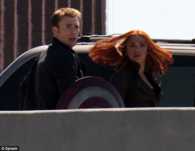 Chris Evans and Scarlett Johansson on the sets of Captain America: The Winter Soldier