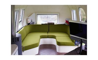 Modern U-shaped sofa in an Airstream.