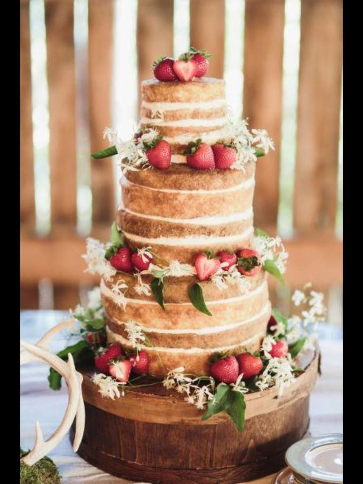 Naked three tier cake with strawberries