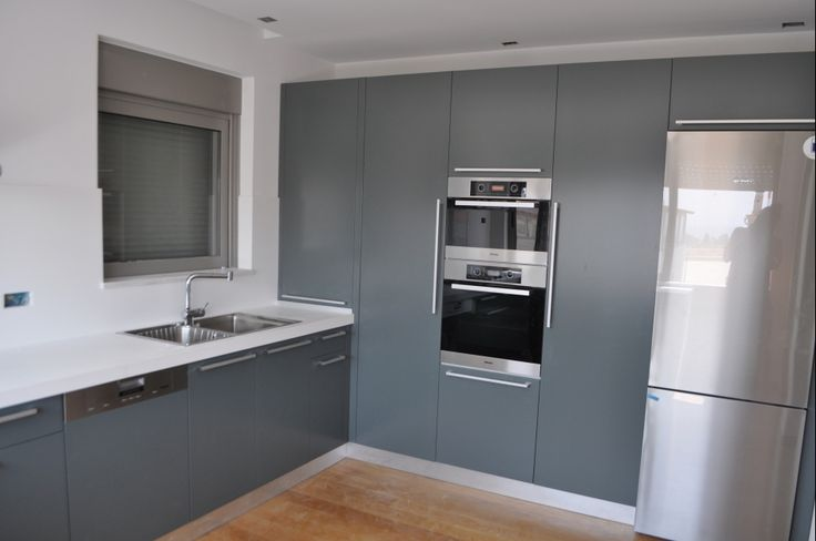 custom made kitchen units, grey laquered cupboards, corian sink, interior design