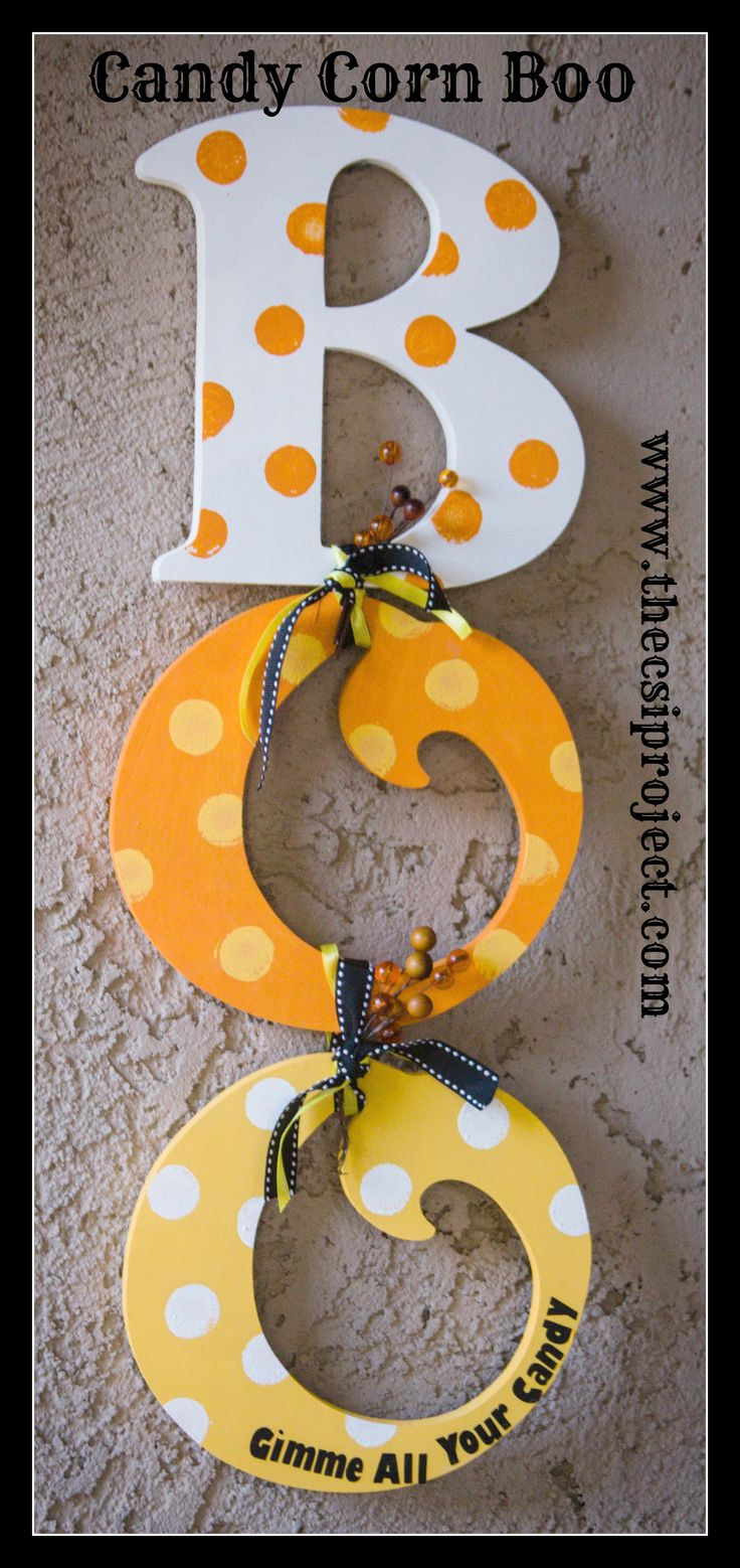 A unique twist on the classic BOO! This door hanger combines the candy corn & the BOO!, two #Halloween staples. | Order your wooden letters to complete this #DIY project sales@diversewoodworking.com