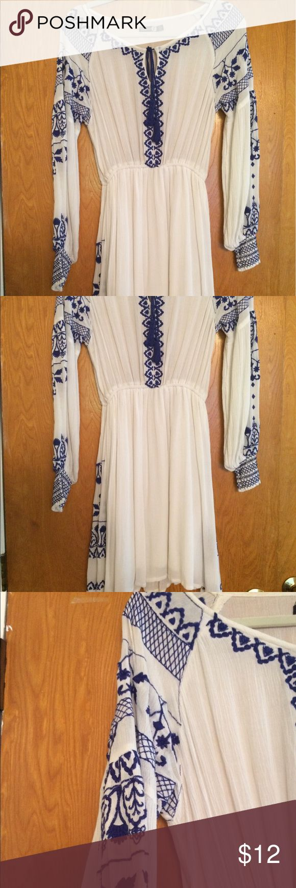 Blue and white embroidered sundress/cover up This pretty summer dress is perfect to go out in or even as a beach cover up. The top is sheer so you either need to wear a nude bra or a came underneath: the bottom half is lined. Beautiful embroidered lines both sides of the dress and down both sleeeves. It has a cute tie at the top. Brand: boohoo. I wore it once and then stashed it in my closet. Boohoo Dresses Mini