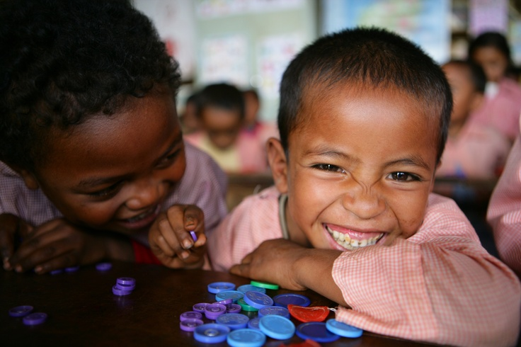 Madagascar: Boys laugh as they perform an exercise in a preschool class at the public primary school in Soavinandriana District, Itasy Region. © UNICEF/NYHQ2009-1243/Giacomo Pirozzi