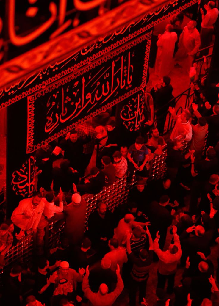 Mourning for Hussein in the month of Muharram inside his shrine in Karbala, Iraq