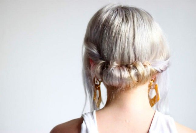Achieve a holiday updo hairstyle with this quick roll + tuck hack.