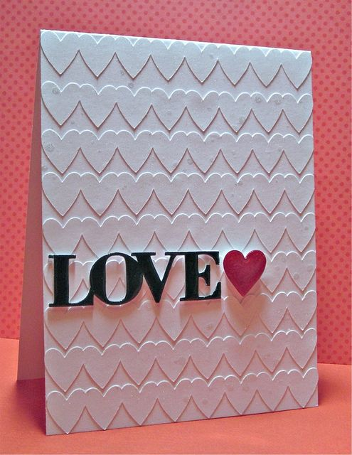 "Lots of plain hearts to create texture-I cut out individual hearts and used dimensional dots to raise them and let the ""Love"" be stuck flat on the raised hearts."