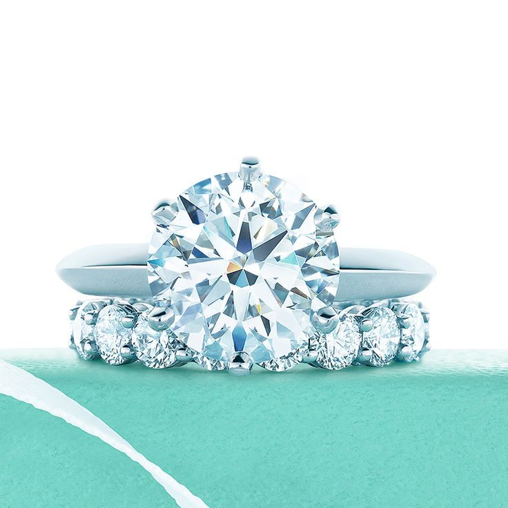 The Tiffany® Setting engagement ring with shared-setting diamond band. #TiffanyPinterest #TiffanyWeddings