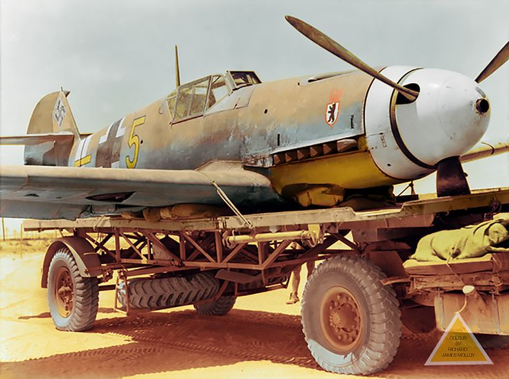 Messerschmitt Bf.109F-4/trop (W.Nr 10074) Gelbe 5 of 6 Staffel, Jagdgeschwader 27, piloted by Leutnant Gerhard Mix, Western Desert, Egypt. 14 August 1942 It had made a forced landing in the rear of the Australian lines near El Alamein and was loaded on to a transport to be taken to RAF workshops to be examined by experts. Other German planes had tried to destroy it after it had landed, in order to prevent disclosing any secret technical developments. Lt. Gerhard Mix was uninjured and taken…