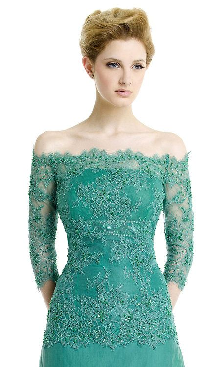 Embroidered turquoise off the shoulder dress.