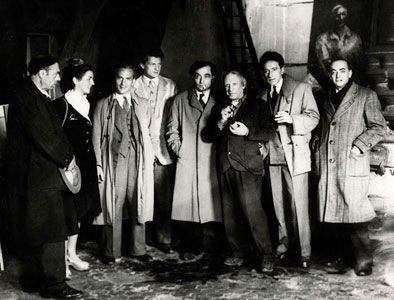 Brassai's photo of a gathering at Picasso's studio. Left to Right: Ortiz de Zarate, Francoise Gilot, Fenosa, Jean Marais, Pierre Reverdy, Picasso, Jean Cocteau and Brassai himself, at Picasso's atelier in the Rue des Grands-Augustins on the Left Bank in Paris