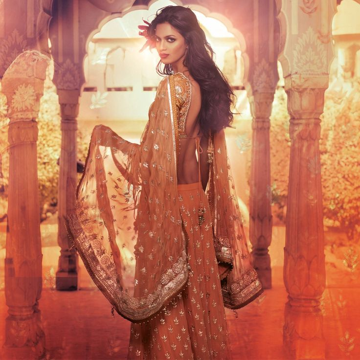 <p>A peach lehenga in the made in a beautiful georgette shimmer fabric and painstakingly and artistically embroidered in the city of jaipur by specialized craft of gota patti work. The sexy low back choli and a similar colour dupatta with gota patti work and finished with rich tissues all around will make the bride blush to peaches and pinks. An heirloom piece to pass down generations.</p>