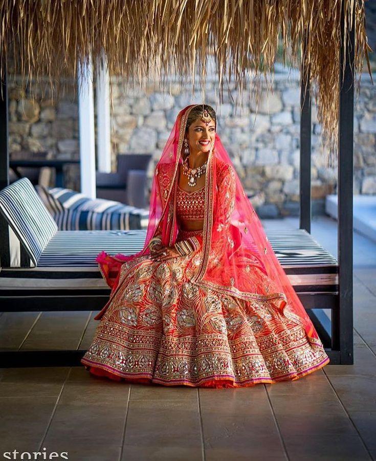 "7,986 Likes, 19 Comments - WedMeGood (@wedmegood) on Instagram: ""A pop of coral !!  @storiesbyjosephradhik  @abujanisandeepkhosla #lehenga #indianbride #coral…"""