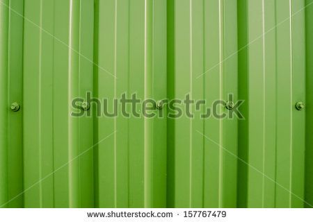 Colorful plastic wall with iron nuts - stock photo