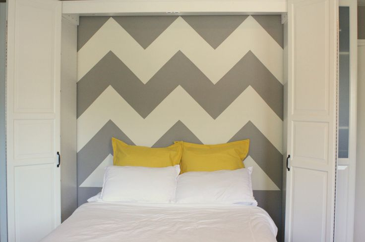 How to paint a chevron wall. This post explains how to get a professional looking chevron painted wall without lots of touch up.