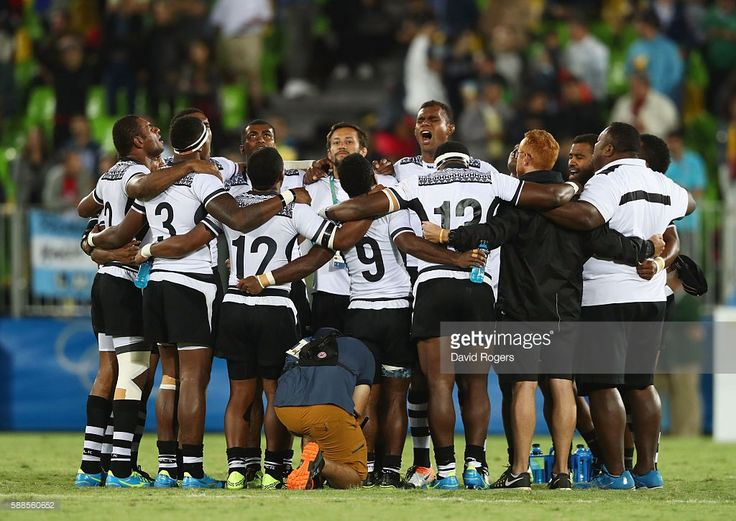 Fiji players and staff huddle as they win gold after the Men's Rugby Sevens Gold medal final match between Fiji and Great Britain on Day 6 of the Rio 2016 Olympics at Deodoro Stadium on August 11, 2016 in Rio de Janeiro, Brazil.