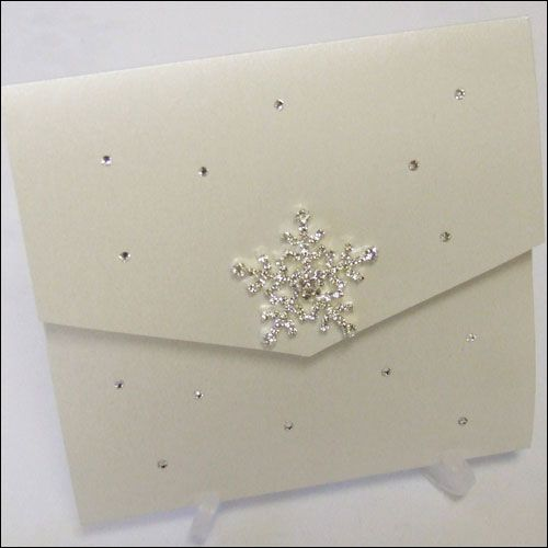Winter wonderland pocketfold invitation finished with a crystal snowflake - featured here in White Micah (pearlised white).