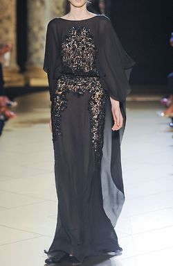 Fashion show in Dubai. I really like sheer long gowns I just look so tiny & even a size 0 won't  fit me. Buying dresses is by far the most challenging when shopping I own 2 dresses & they're both made of cotton &  look really odd on me its a shame :/