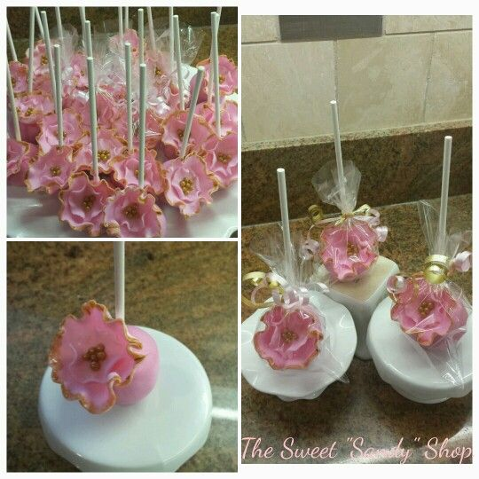 Elegant cake pops with handmade edible flowers and sugar beads painted with edible gold paint