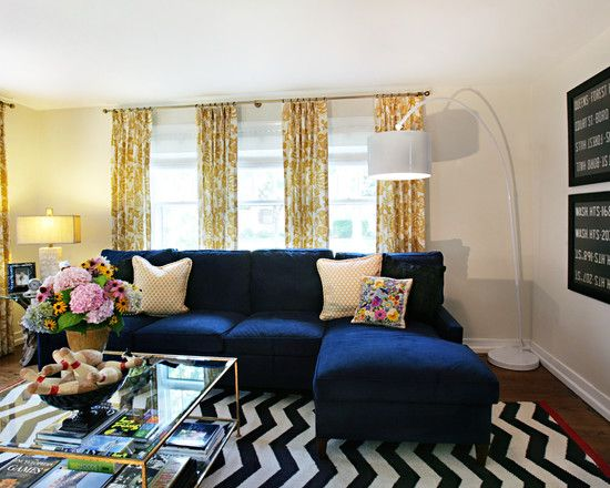 chevron rug, navy sofa, yellow print curtains.                                                                                                                                                      More