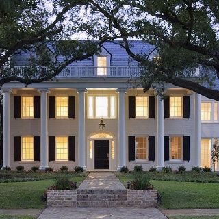 White house black shutters but with a red door home for Southern plantation shutters