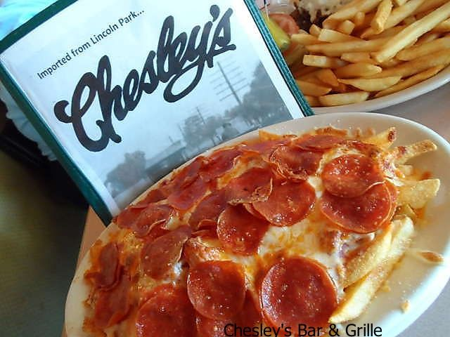 Heaping platter of golden fries topped with pizza sauce, melted mozzarella and pepperoni - delish!