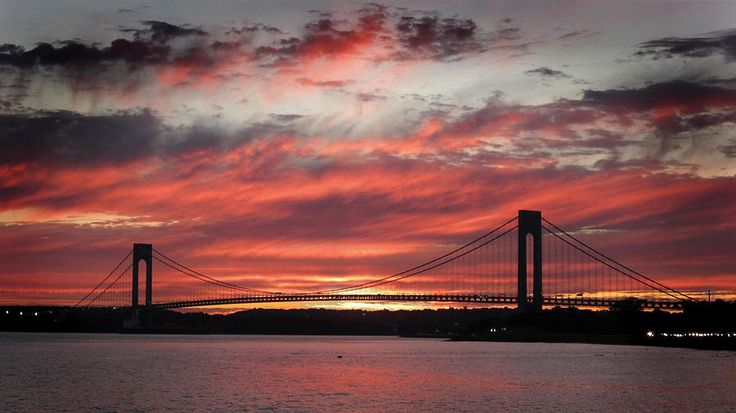 Incredibly stunning sunset at the Verrazano Narrows Bridge on the day after Hurricane/Tropical Storm Irene came through New YorK City on August 29, 2011. Description from pixels.com. I searched for this on bing.com/images