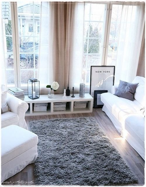 Grey rug and sheer curtains. Again the perfect shade of hardwood flooring. Love the low shelf/storage combo, could see this in our downstairs living room