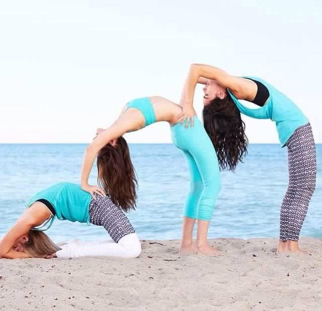 Three Person Yoga Bend Into King Pigeon Pose