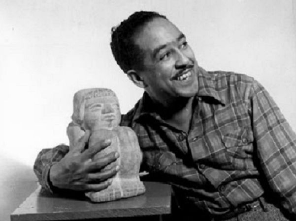 """Photo: Langston Hughes, 1943. Credit: Gordon Parks; Library of Congress, Prints and Photographs Division. Read more on the GenealogyBank blog: """"On This Day: 'Harlem Renaissance' Author Langston Hughes Died"""" https://blog.genealogybank.com/on-this-day-harlem-renaissance-author-langston-hughes-died.html"""