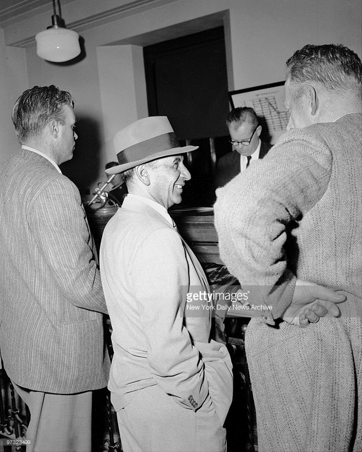 Meyer Lansky (center) jokes with a detective at the West 54th Street Police Station. He is being questioned about the Albert Anastasia killing.