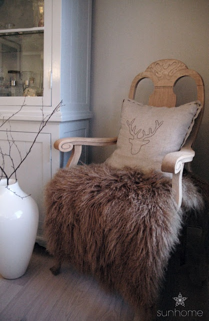 An old chair with a pillow I have made and a sheep throw. http://anettewillemine.blogspot.com