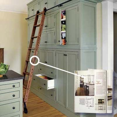 floor to ceiling cabinets. Love the ladder.