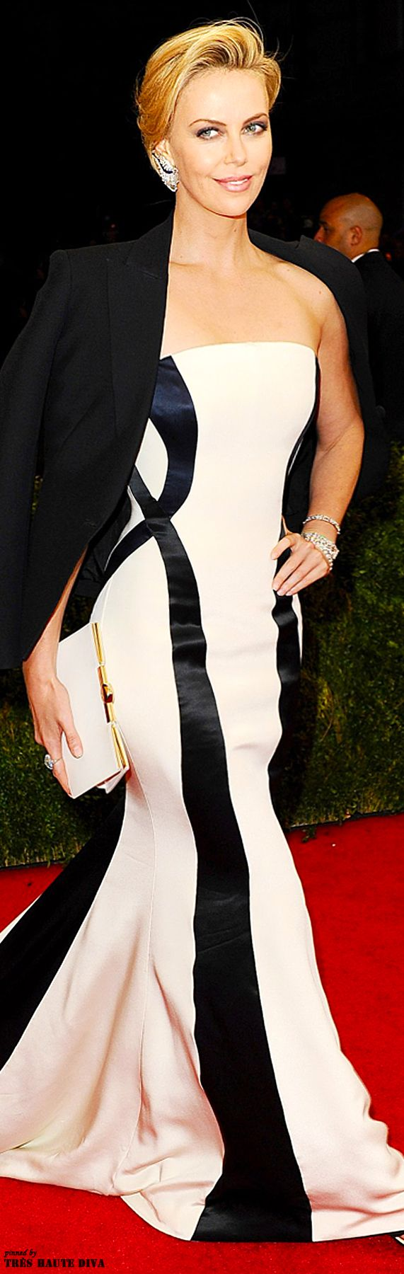 Charlize Theron in Dior Couture gown with tuxedo jacket at the 2014 Met Gala