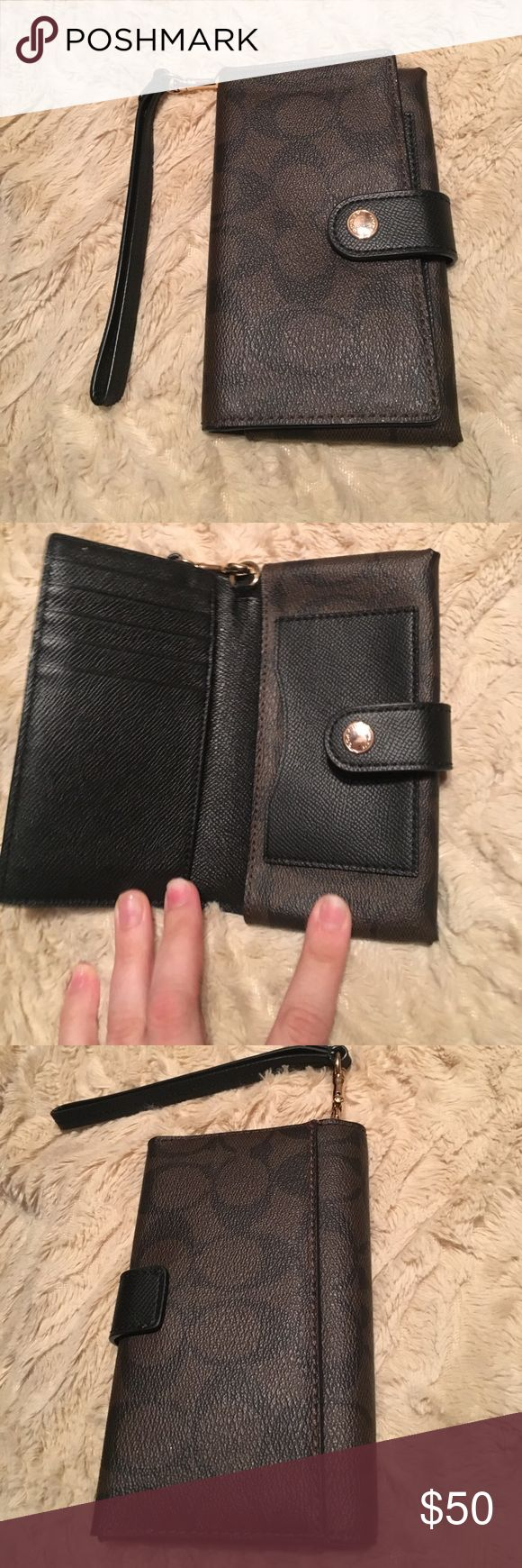 Barely used Coach wristlet Perfect size to fit all your essentials like phone, credit cards, and money. Was barely used so it looks just like new! Coach Bags Clutches & Wristlets