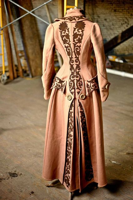 Wicked awesome coat!!! I'm even OK with that shade of pink as it looks faboo with the brown accents!