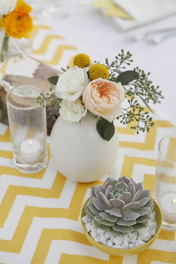 Wedding centerpiece: yellow chevron table runner (easy to DIY), peonies & billy buttons, white vase